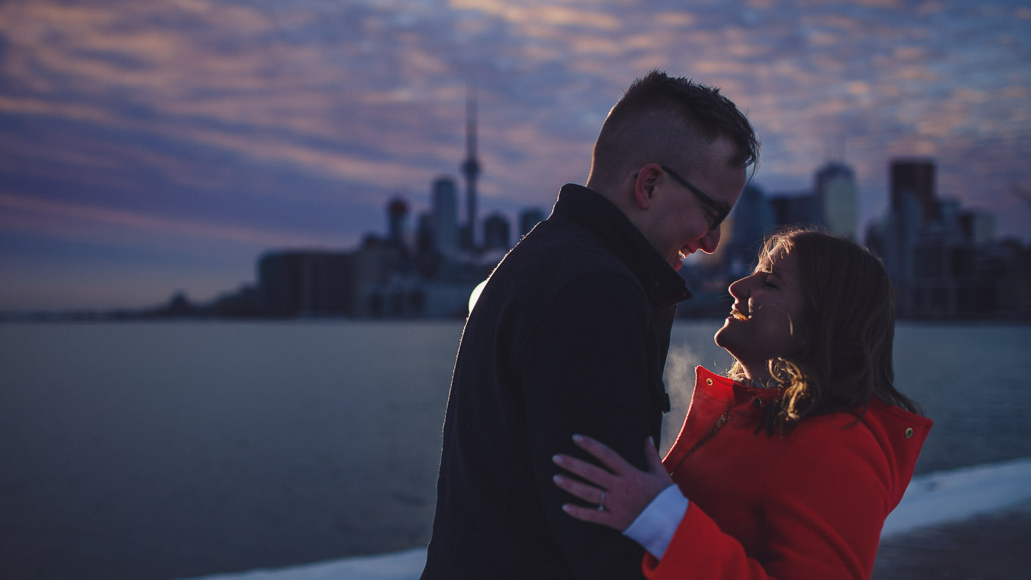 Couple in front Toronto skyline engagement session