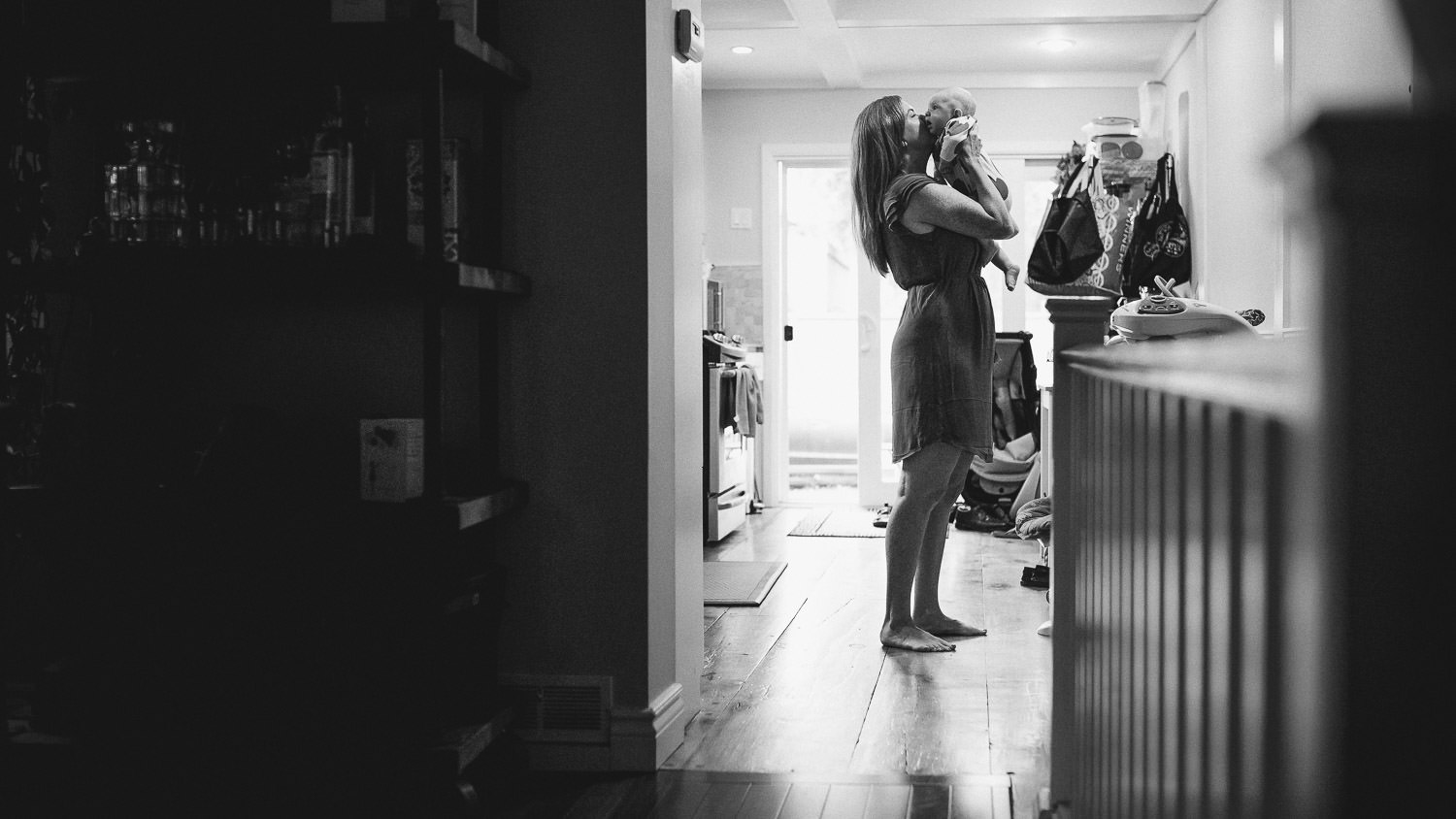 Toronto mom kisses her baby in the kitchen