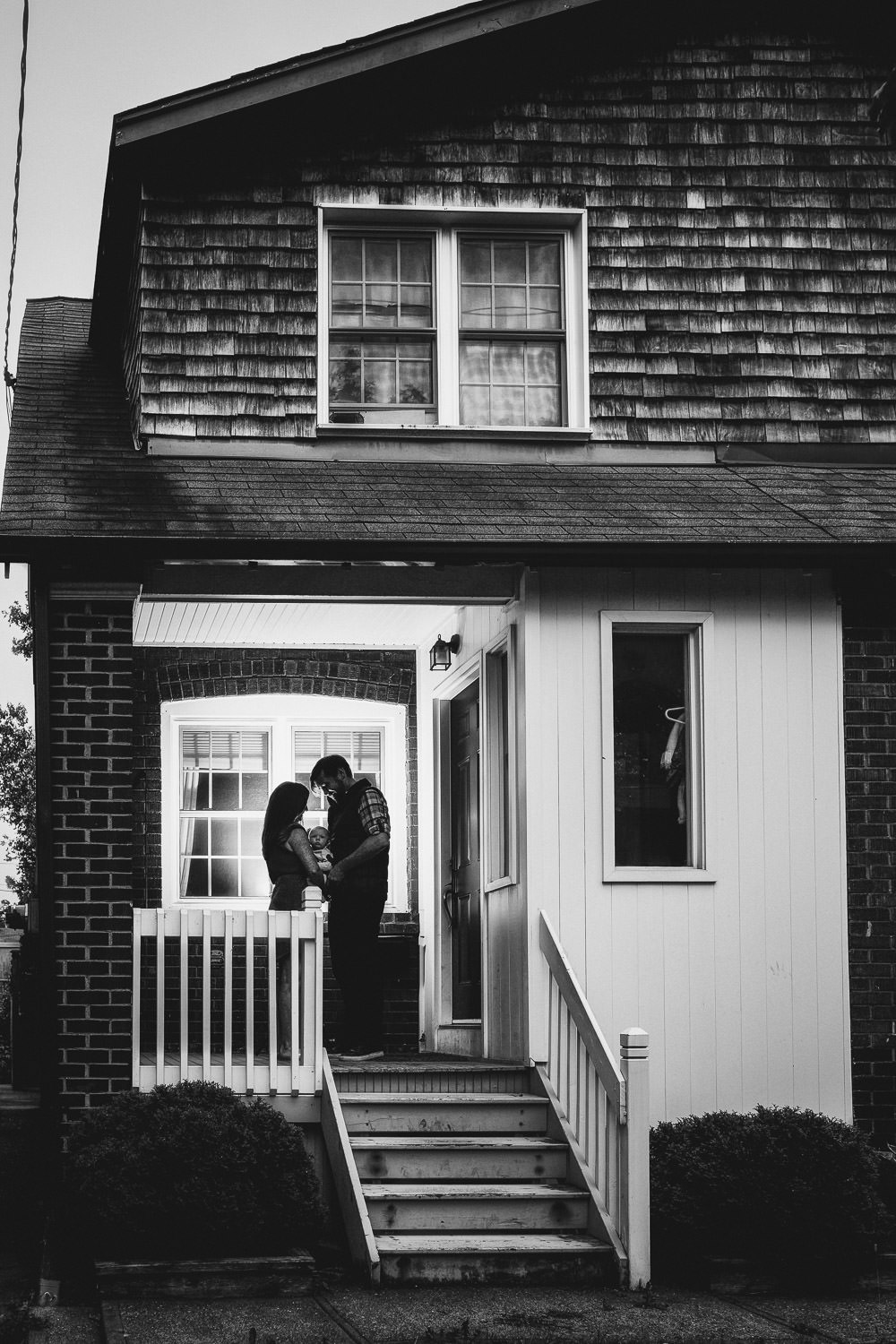 Family in front of Toronto home