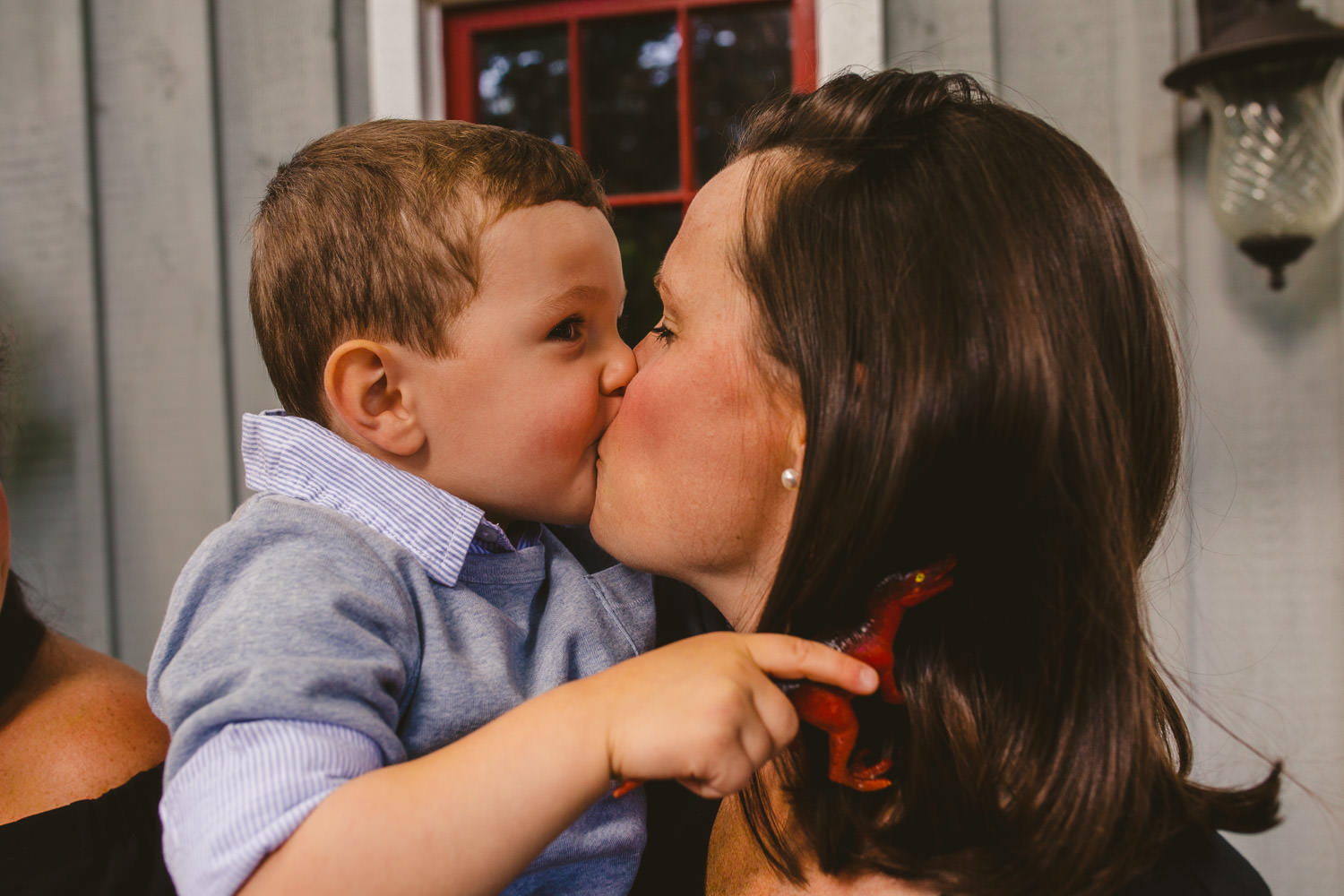 Little boy kissing his mom