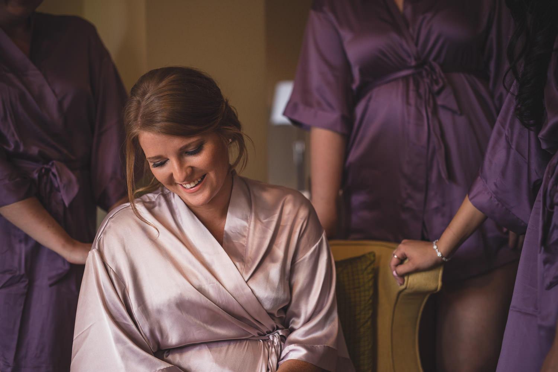 Bride laughs with her bridesmaids at Muskoka Bay Resort