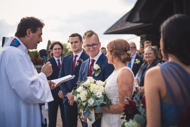 Groom looks lovingly at his bride at altar at Muskoka Bay Resort
