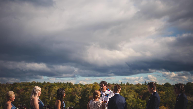 Wedding party at altar under sunny sky at Muskoka Bay Resort