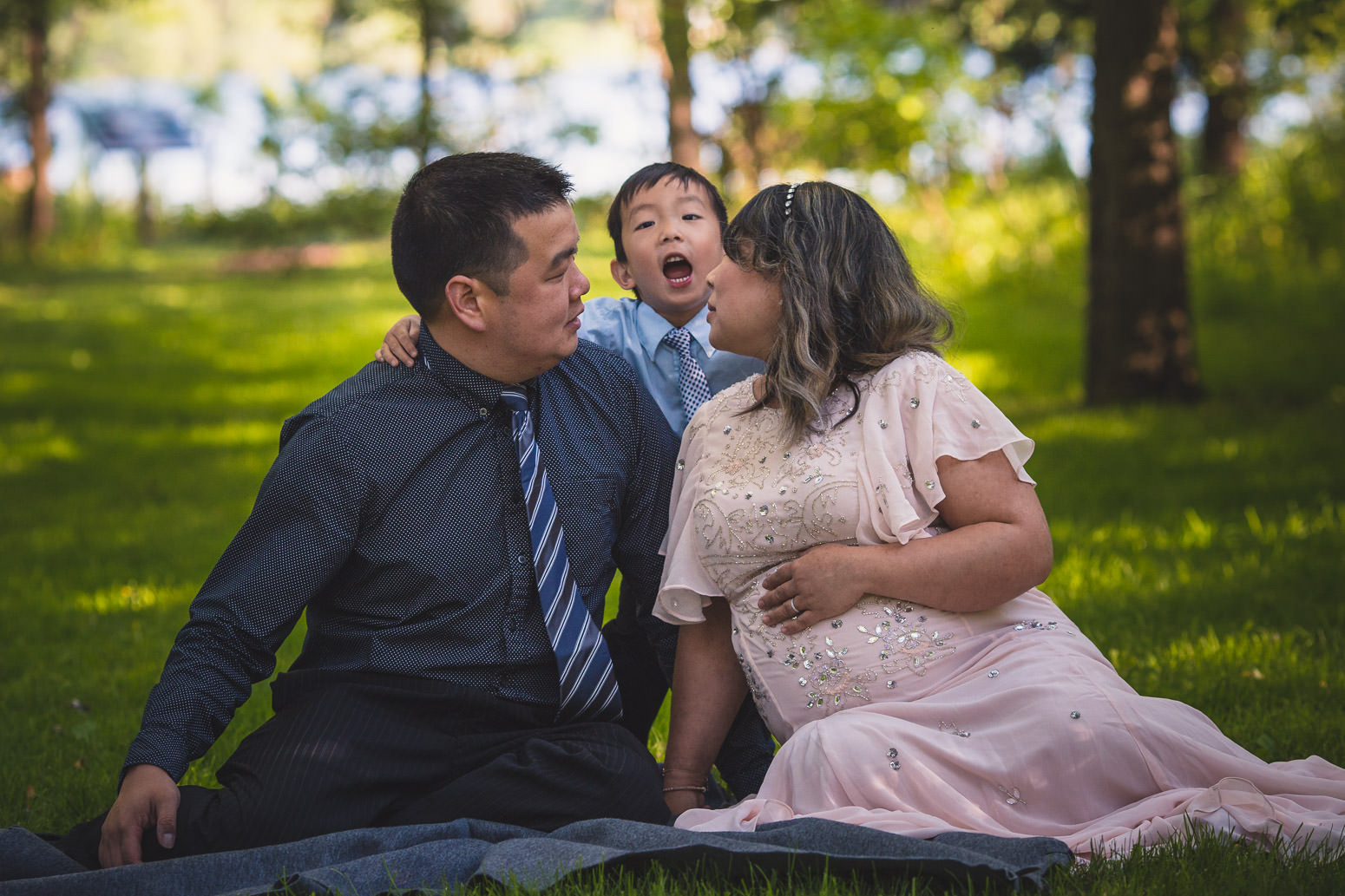 Family together during maternity photo session son makes funny face