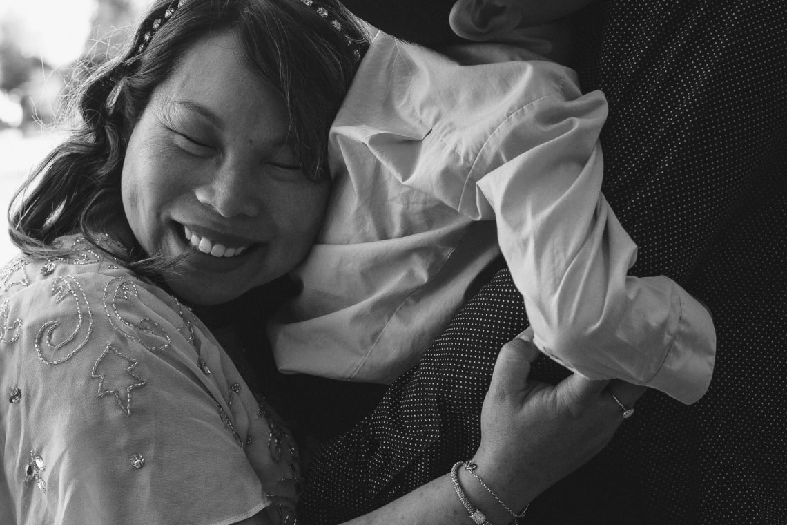 Mom hugs son during maternity photo session