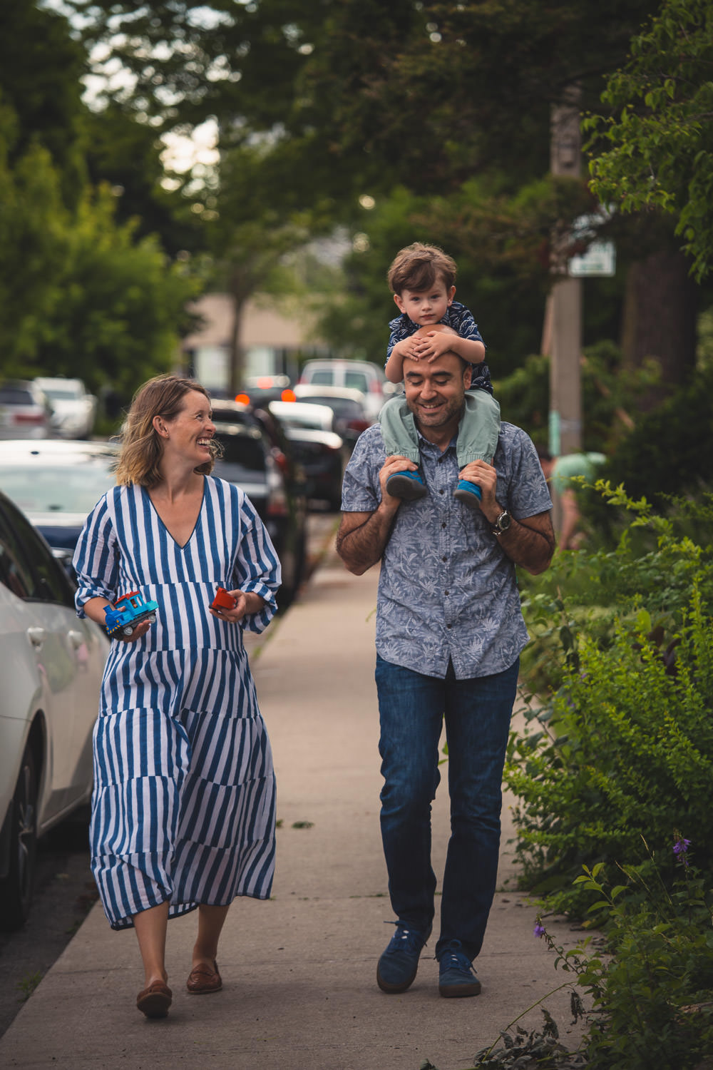 Parents walking with son during toronto maternity photo session