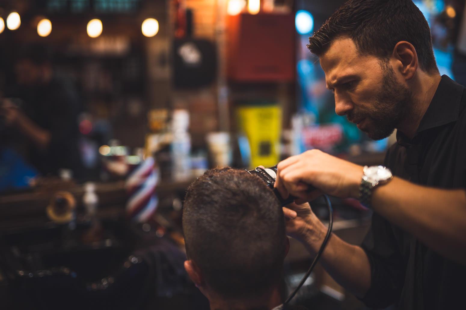 Barber cuts hair at Johnny Cuts Barbershop in Oshawa