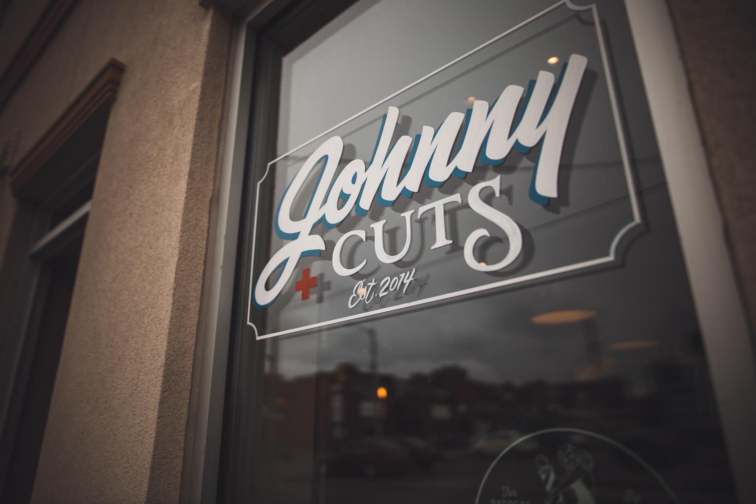 Johnny Cuts Barbershop front window Oshawa
